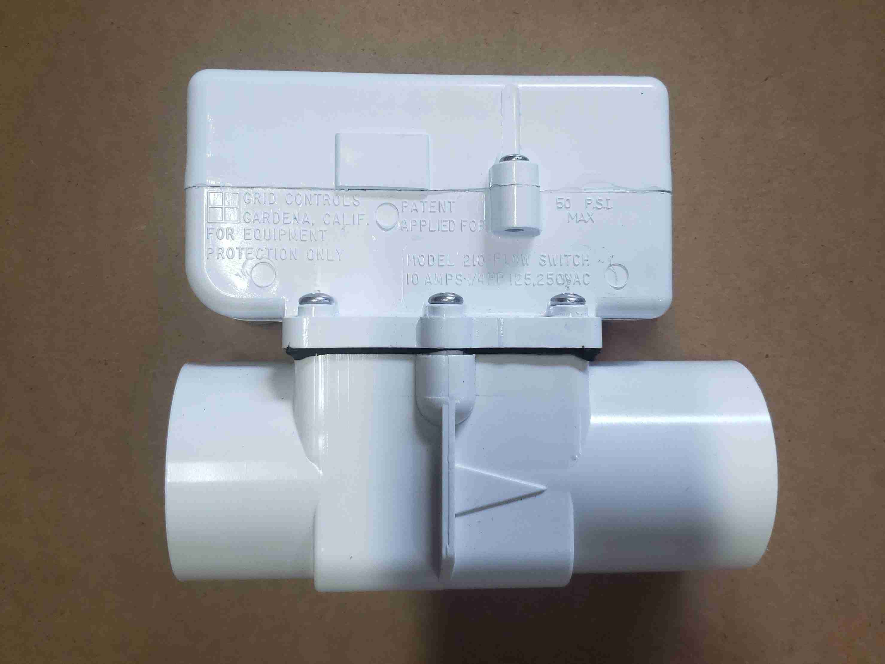 Side view of Grid Controls M210 External Flow Switch for Heat Pump