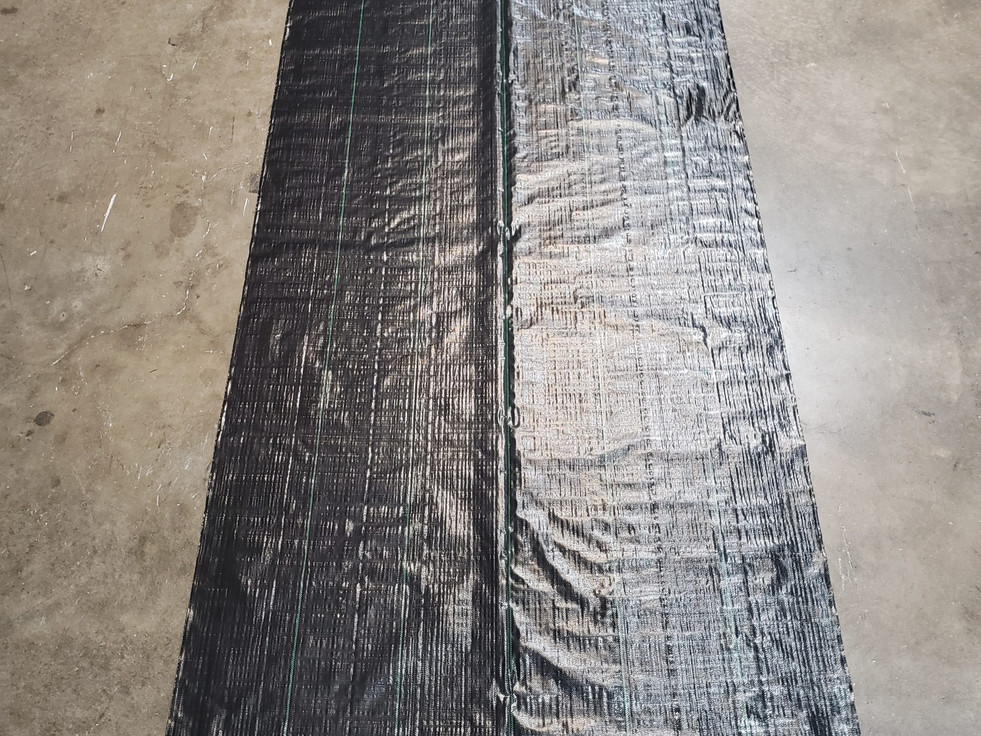 Underlayment weed barrier rolled out